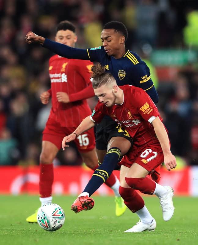 Harvey Elliott battles Arsenal's Joe Willock on Wednesday night. (Image Credit: PA)