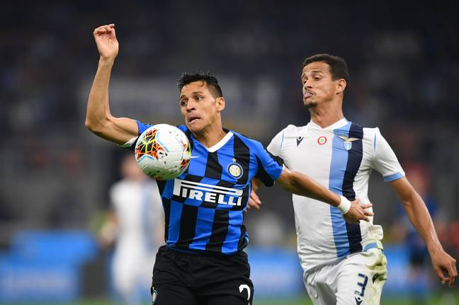 Sanchez (L) in action for Inter. (Image Credit: PA)