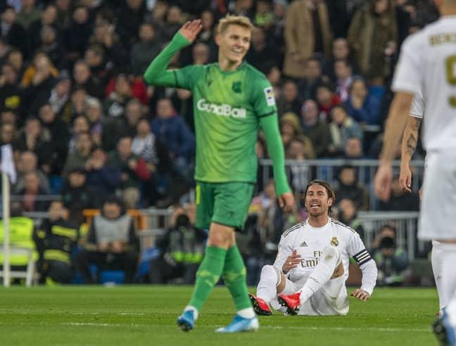 Odegaard dismissing Ramos. Image: PA Images