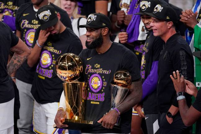 LeBron James holds up his Finals MVP award and the NBA Championship trophy. Credit: PA