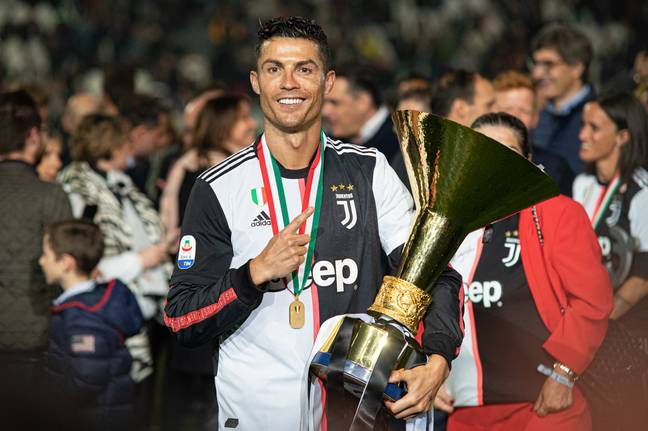 Ronaldo with the trophy and the controversial shirt. Image: PA Images