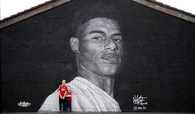 A mural of Rashford in Manchester. Credit: PA
