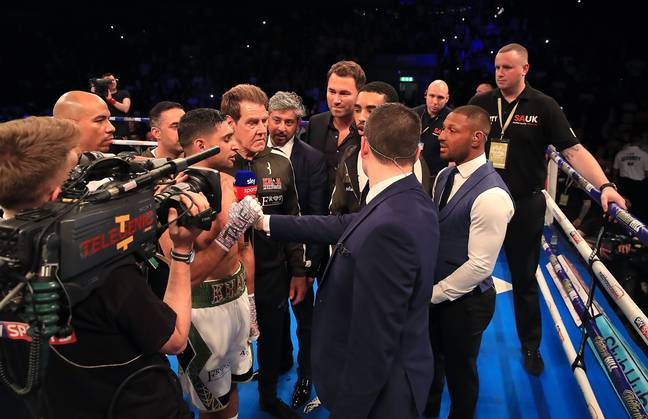 Brook enters the ring and sparks a war of words with Khan. Image: PA