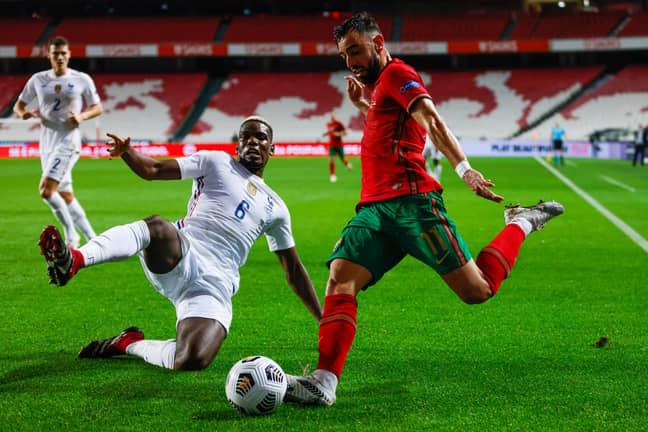 Pogba tackles United teammate Bruno Fernandes. Image: PA Images