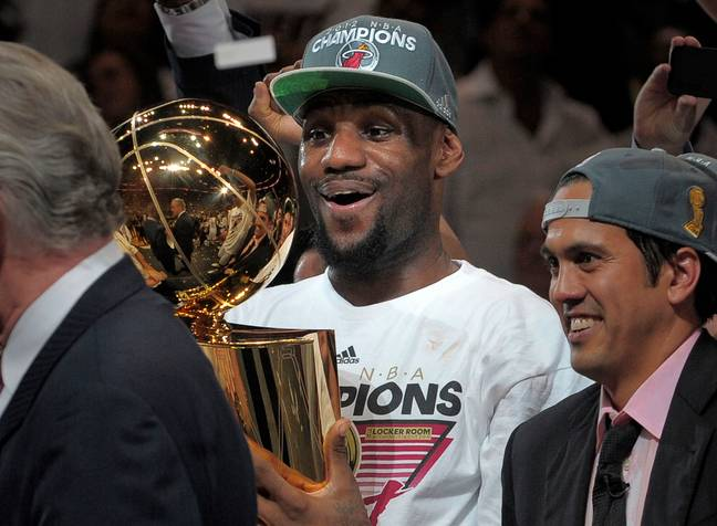 LeBron lifts his first trophy in 2012. Image: PA Images