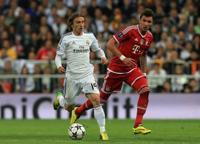 Modric holds off a challenge from Bayern Munich's Mario Mandzukic in the Champions League semi-final. Image credit: PA