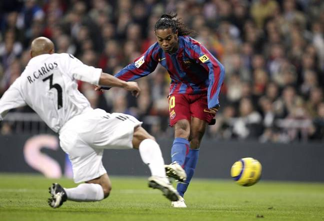 Ronaldinho taking on the left back in his team. Image: PA Images