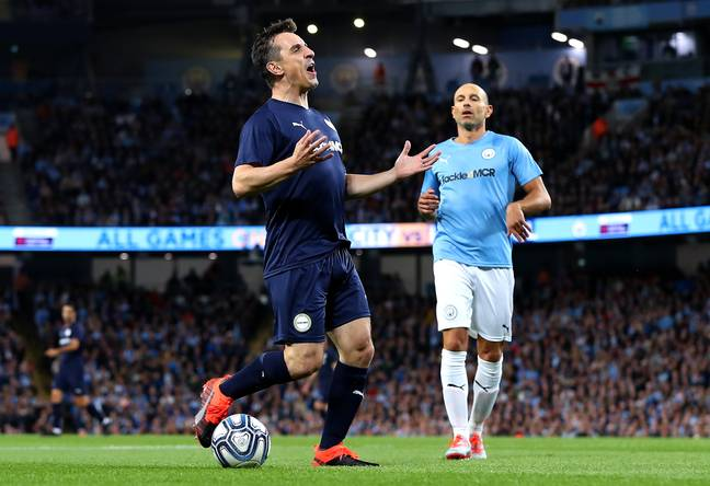 Neville in action at Kompany's testimonial (Image Credit: PA)