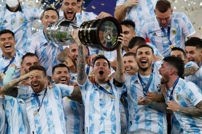 Lionel Messi hoists the trophy up after Argentina beat Brazil in the Copa America (Credit: PA)
