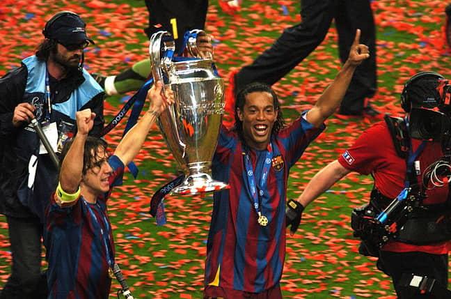 Ronaldinho celebrates with the Champions League trophy. Image: PA Images