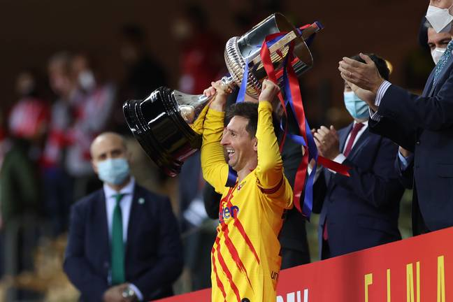Messi looked extremely happy to lift the Copa del Rey for Barca last season. Image: PA Images