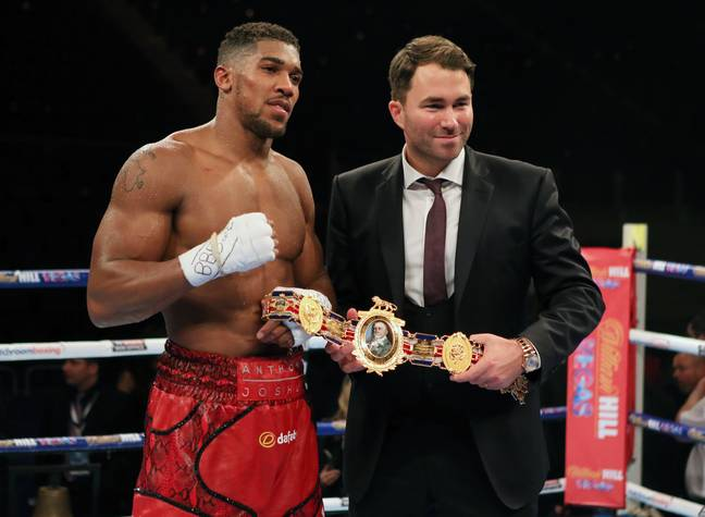 Anthony Joshua and his promoter Eddie Hearn. Credit: PA