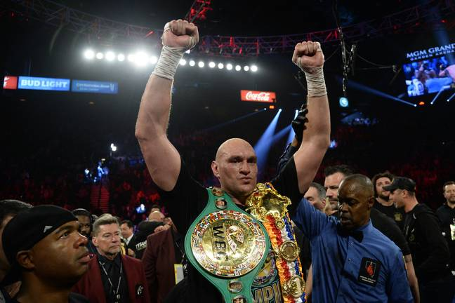 Fury celebrates with his new belts. Image: PA Images