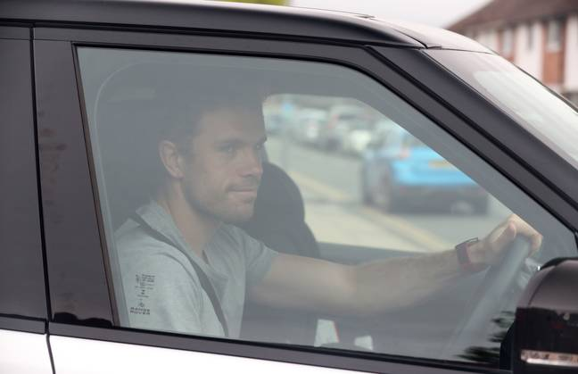 Jordan Henderson arrives at Liverpool training. Image: PA