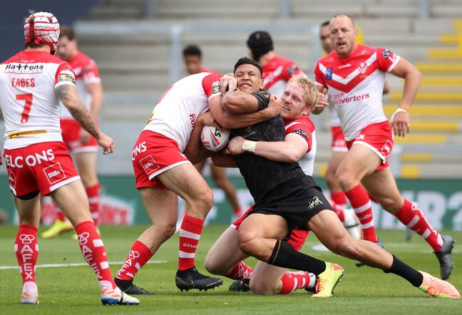 Israel Folau is tackled by St Helens players. Credit: PA