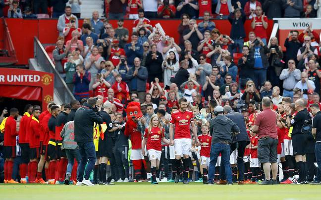 Carrick leads out the United team through a guard of honour. Image: PA