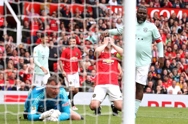 Neville falls to his knees after missing the shot. Image: PA Images