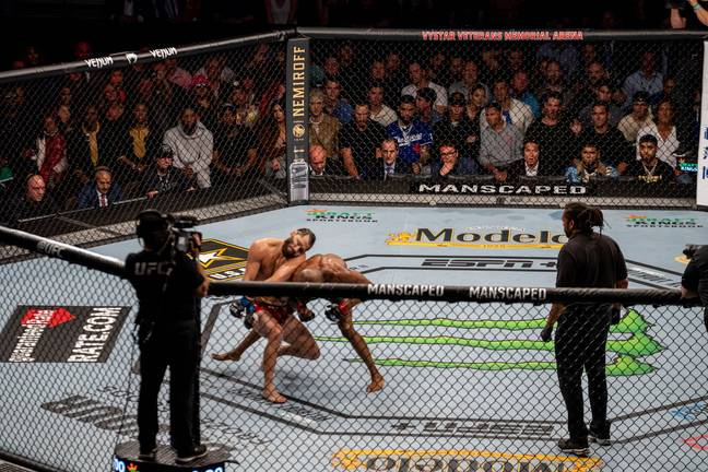An incredible image showing the end of UFC 261's main event. Image: UFC