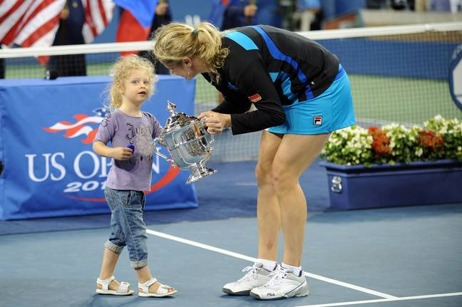Clijsters is pictured with her daughter after winning the US Open. Credit PA