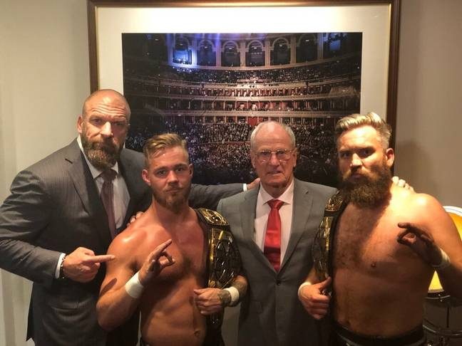 Trent Seven (Far R) and tag team partner Tyler Bate (L) with Triple H and Johnny Saint. (Image Credit: Triple H/Twitter)