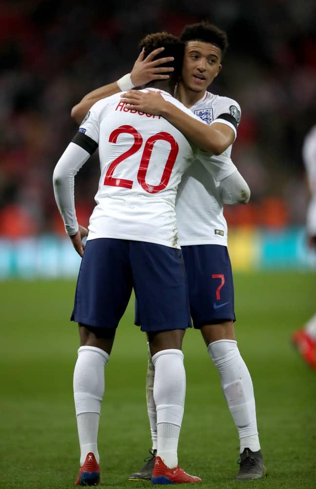 England's Jadon Sancho and Callum Hudson-Odoi embrace after the UEFA Euro 2020 Qualifying against Czech Republic. Image credit: PA