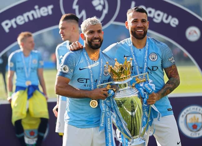 Otamendi (right) and Sergio Aguero celebrate winning the Premier League. Credit: PA