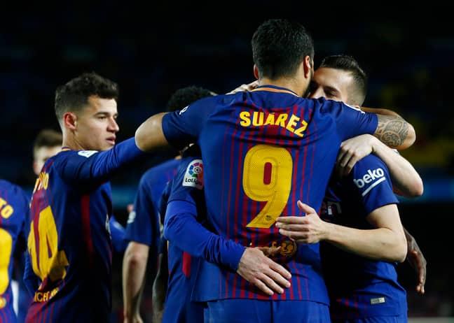 Suarez celebrates with his teammates. Image: PA