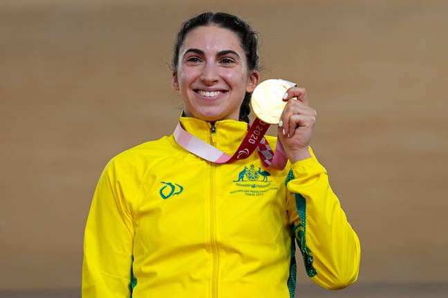Australia's Paige Greco holds her gold medal after winning the Cycling Track Women's C1-3 3000m Individual Pursuit. Credit: PA