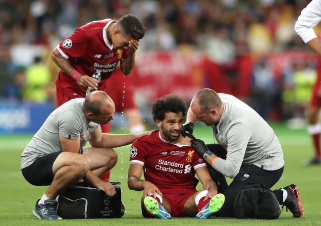 Salah receives treatment on his shoulder. Image: PA