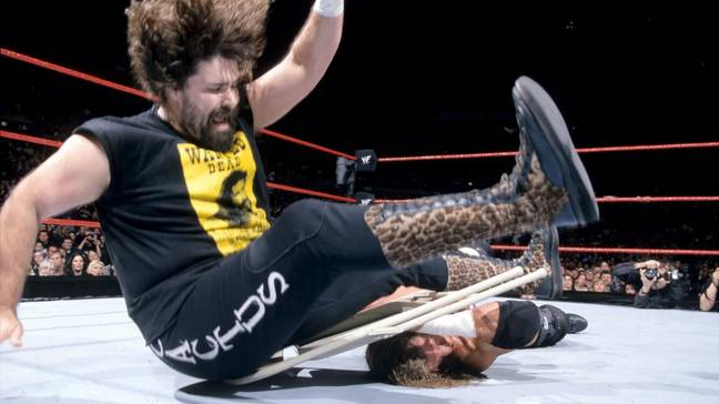 Foley hits a leg drop on a chair to HHH at the 2000 Royal Rumble. Image: WWE.com