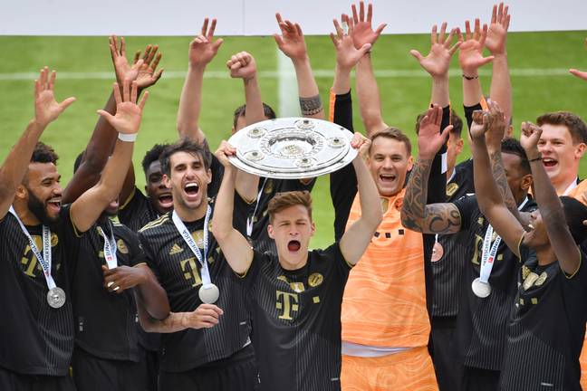 Kimmich lifts the Bundesliga title. Image: PA Images