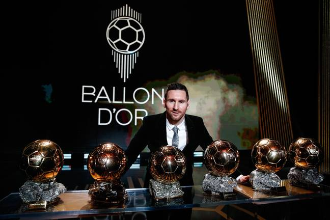 Messi with his six Ballon d'Ors. Image: PA Images