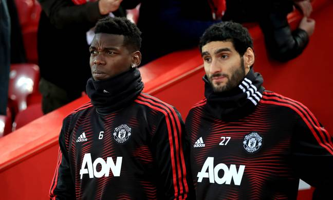 Fellaini on the bench with Paul Pogba in Jose Mourinho's last game in charge. Image: PA Images