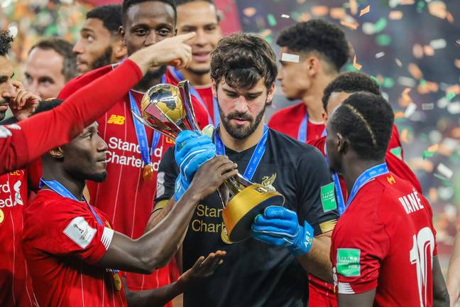 Alisson with the FIFA World Club Cup trophy. Image: PA Images