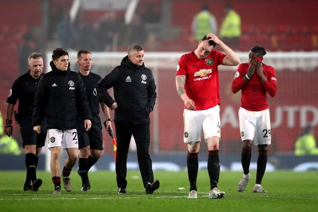 United players and management trudge off after the embarrassing night at Old Trafford. Image: PA Images