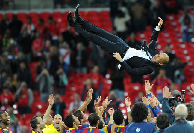 Guardiola is thrown into the air by his Barcelona squad after winning the competition in 2011. (Image Credit: PA)