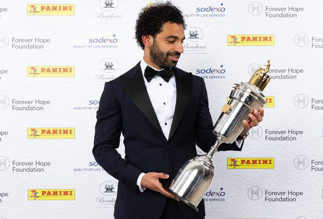 Salah with the PFA Player of the Year trophy. Image: PA