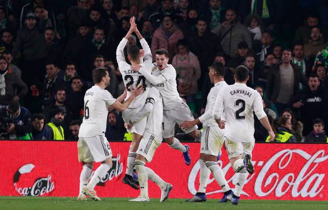 Real players celebrate with Ceballos. Image: PA Images