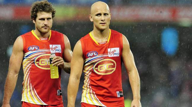 Brown (left) playing for the Gold Coast Suns. Credit: Twitter/SuperFooty