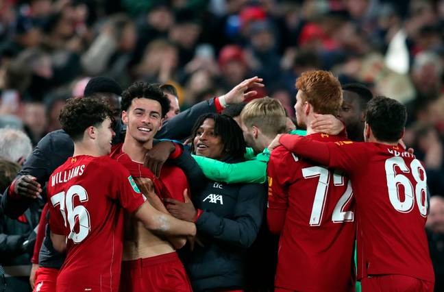 Liverpool celebrate after beating Arsenal 5-4 on penalties on Wednesday night. (Image Credit: PA)