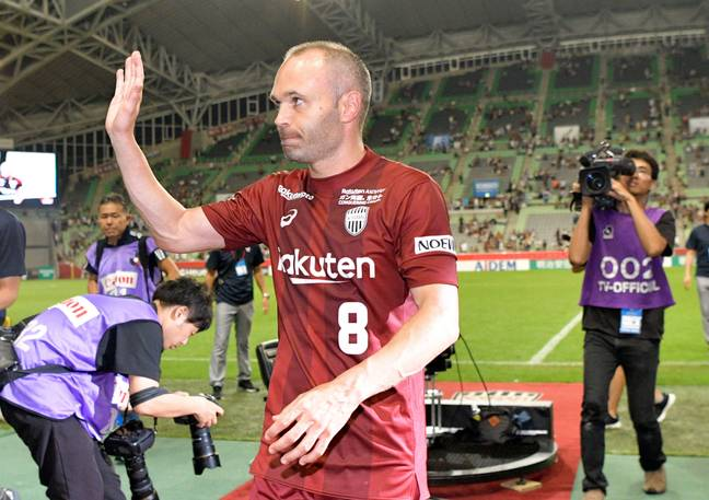 Iniesta waves to the fans. Image: PA