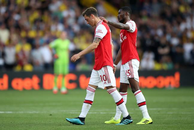 Arsenal players walk off the pitch after throwing away a win against Watford. Image: PA Images