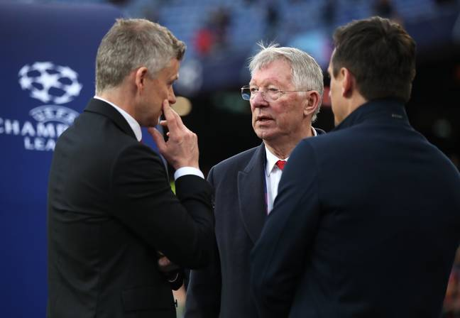 Ferguson talking to former players Ole Gunnar Solskjaer and Gary Neville. Image: PA Images