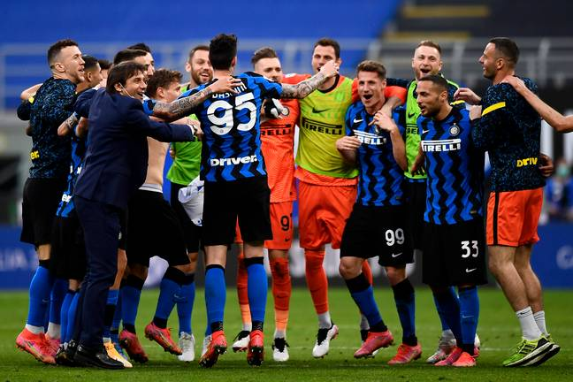 Conte celebrates with his players, having been crowned champions of Italy. Image: PA Images