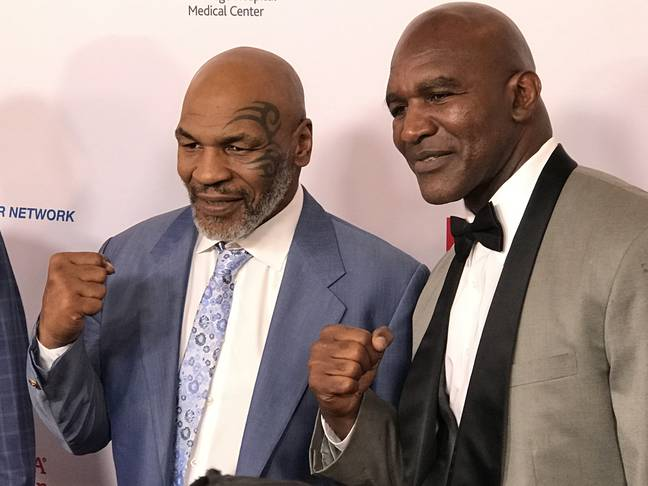 Holyfield with former rival Mike Tyson. Image: PA Images