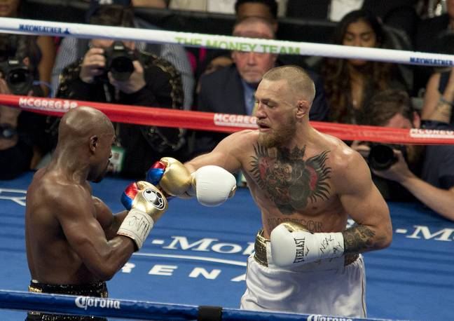 McGregor and Mayweather during their fight. Image: PA Images
