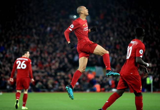 Fabinho celebrates putting Liverpool ahead, on their way to opening up a nine point gap. Image: PA Images