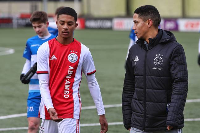 Ajax academy coach Steven Pienaar with one of his players. Image: PA Images