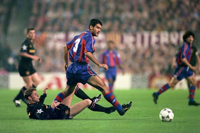 Nicky Butt and Pep Guardiola tangle during a 4-0 win to Barcelona. Image: PA Images