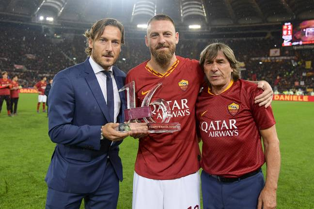 Totti as club director when former teammate Daniele de Rossi was leaving the club. Image: PA Images